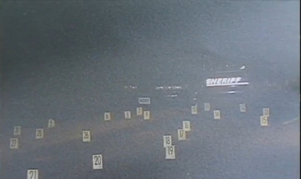 Numbered placards indicating where shell casings landed during the gunfight